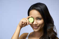 woman with cucumber photo